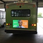 Campaign image for exterior rear digital bus signage.