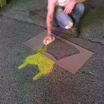 Testing the Framework: applying surface marking with temporary spray chalk and customized stencils.