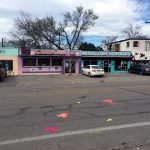 "Testing the Framework: ""Chalk Dirty To Me"" crosswalk intervention. View looking across North Loop Blvd to Forbidden Fruit sex toy shop."