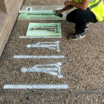 Testing the Framework: application of scooter parking markings using temporary spray chalk and customized stencils.